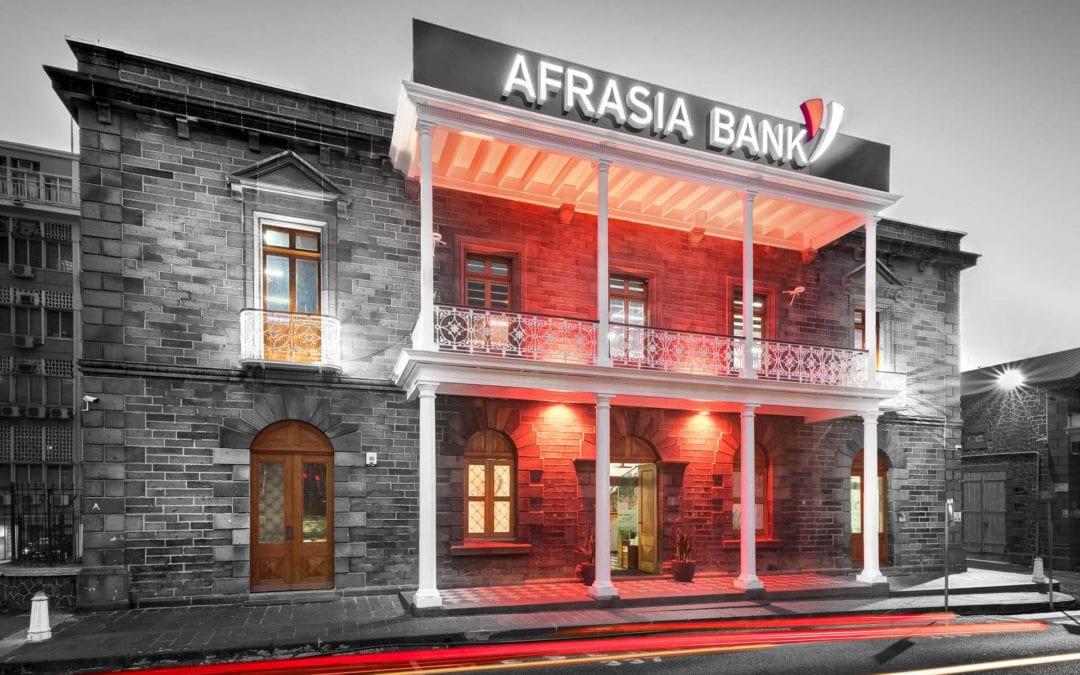 Allan Juste and Jolene Li Sing How from AfrAsia Bank honoured by the prestigious Elliot Wave International certification